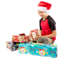 12 year old boy sitting with presents