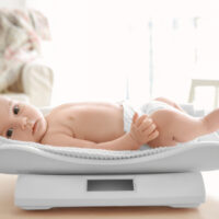 baby laying on a baby scale
