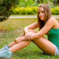 16 year old girl sitting in the park