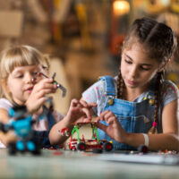 two girls playing with building set