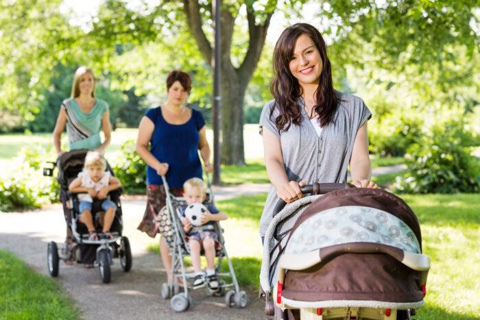 3 moms pushing strollers