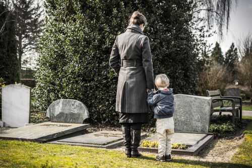 mom and son at graveside