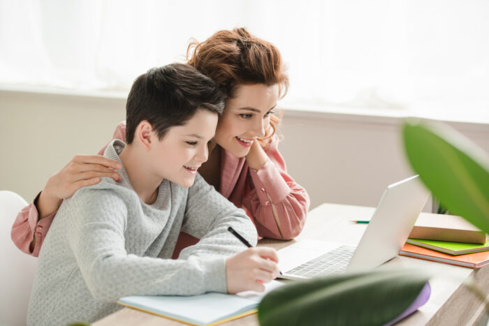 mother and son homeschooling together