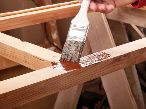 staining baby gate wood frame with brush